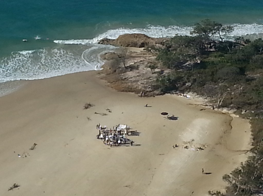 Aerial picture of a beach wedding