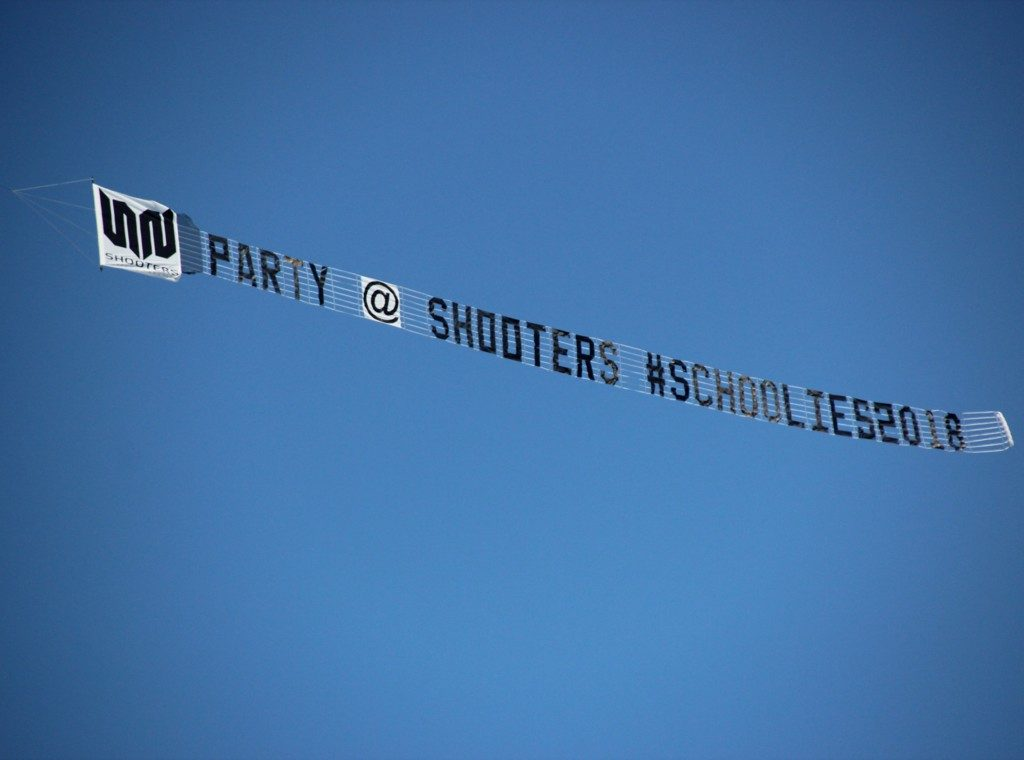 shooters schoolies sky sign. with shooters logo at the front of the banner