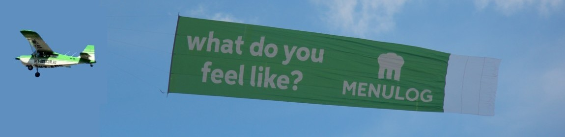 slider-Menulog-business-marketing-billboard-behind-aircraft