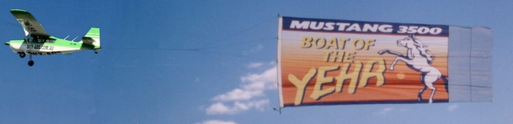 "Example of Aerial Billboard which reads ""Mustang boat of the year"""