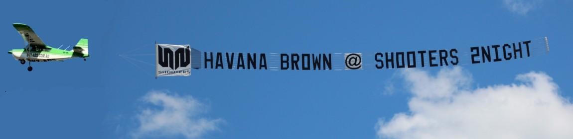 slider-shooters-business-marketing-banner-behind-aircraft