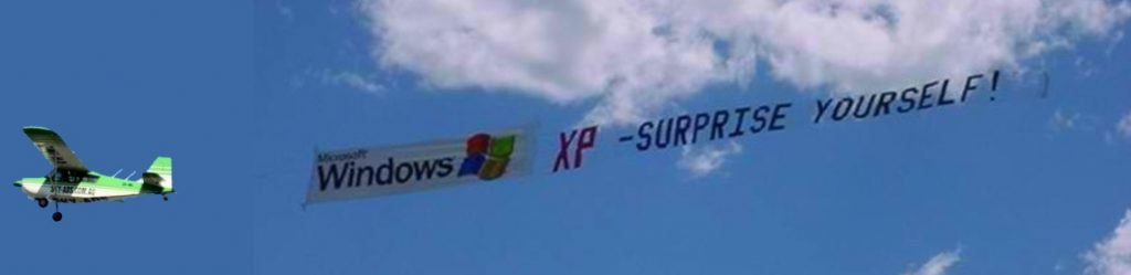 windows air-sign flying behind sky-ads aircraft