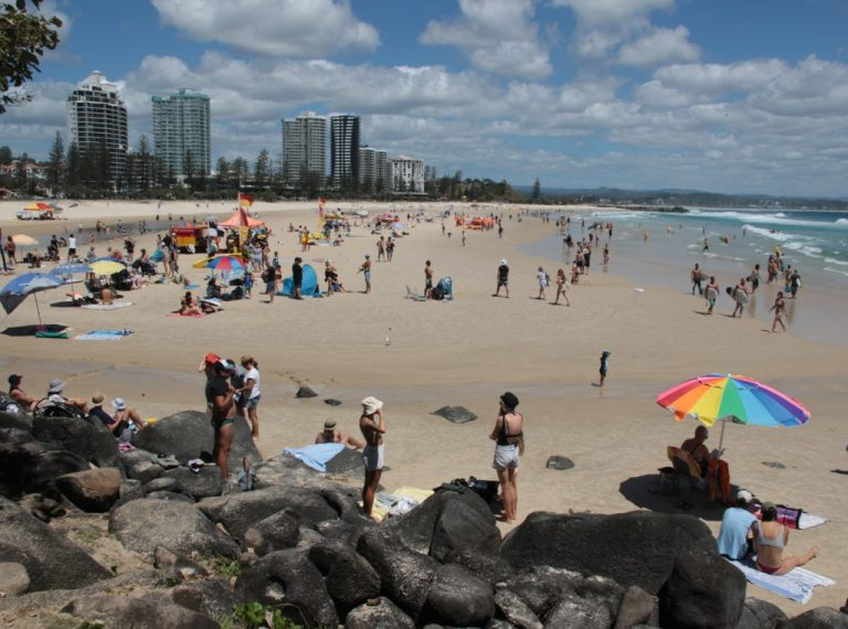 Crowds enjoying Greenmount beach. Demonstrates SKY-ADS Market