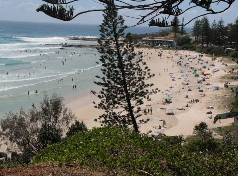 Huge number of people on rainbow bay beach. As seen from lookout