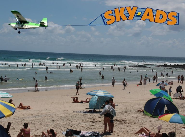 Crowded Beach audience looking up at SKY-ADS aerial display