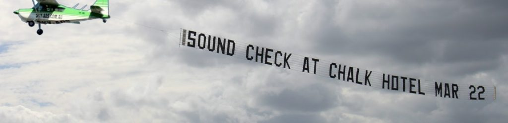 chalk hotel aerial advertising banner behind our aircraft