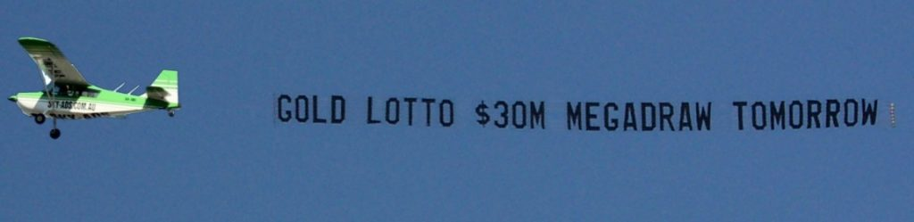 gold lotto banner towing. behind sky-ads aircraft