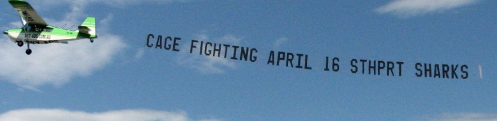 aerial promotion reads. cage fighting, april 16, southport sharks