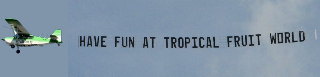 tropical fruit world aerial advertising flying past