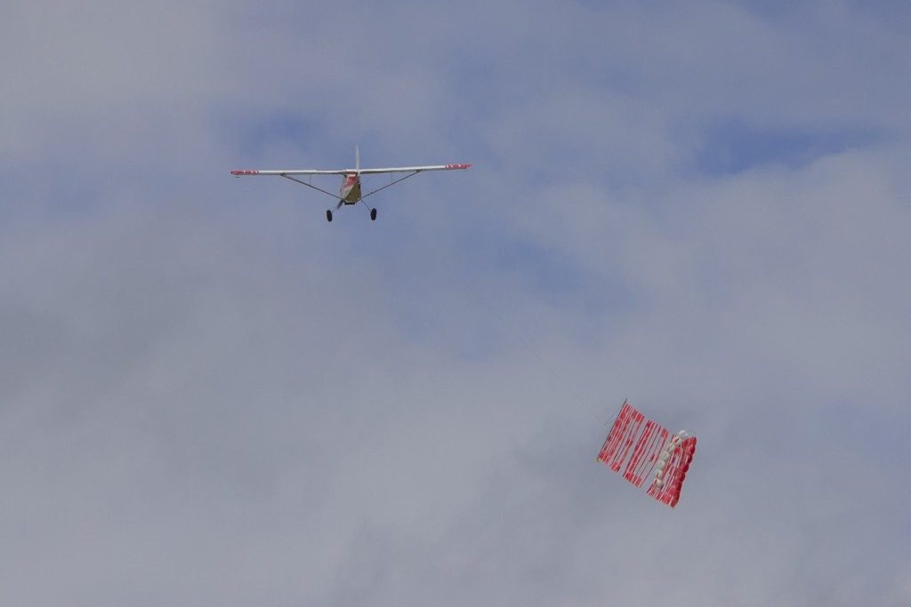 flying sign layed over