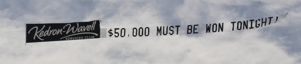 """Aerial Advertising saying """"$50,000 Must be Won Tonight"""""""