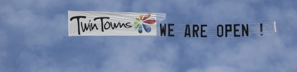 "Sky Display ""Twin Towns Logo followed by We Are Open"""