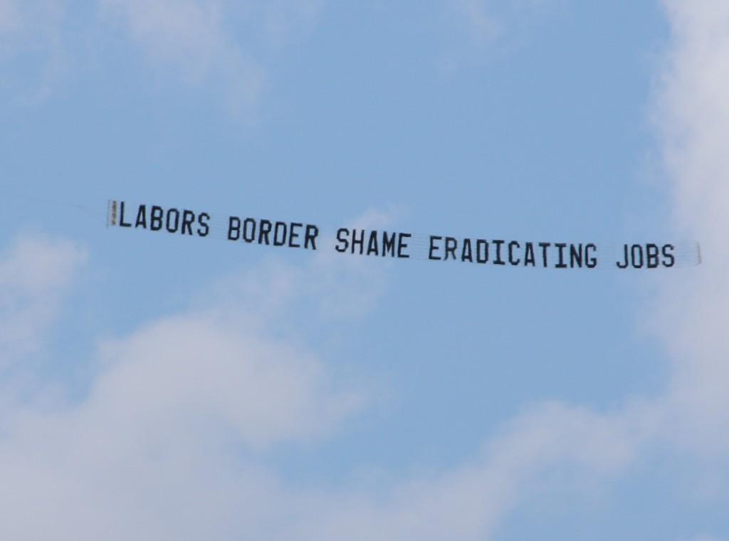 "Protest Aircraft displays ""LABORS BORDER SHAME ERADICATING JOBS"