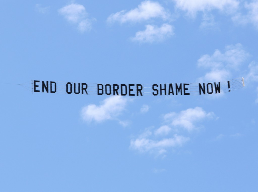 "Protest Aeroplane Banner reads ""End our Border shame Now !"""