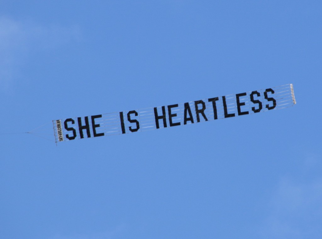 "Protest Aircraft dragging sign ""She is Heartless"""