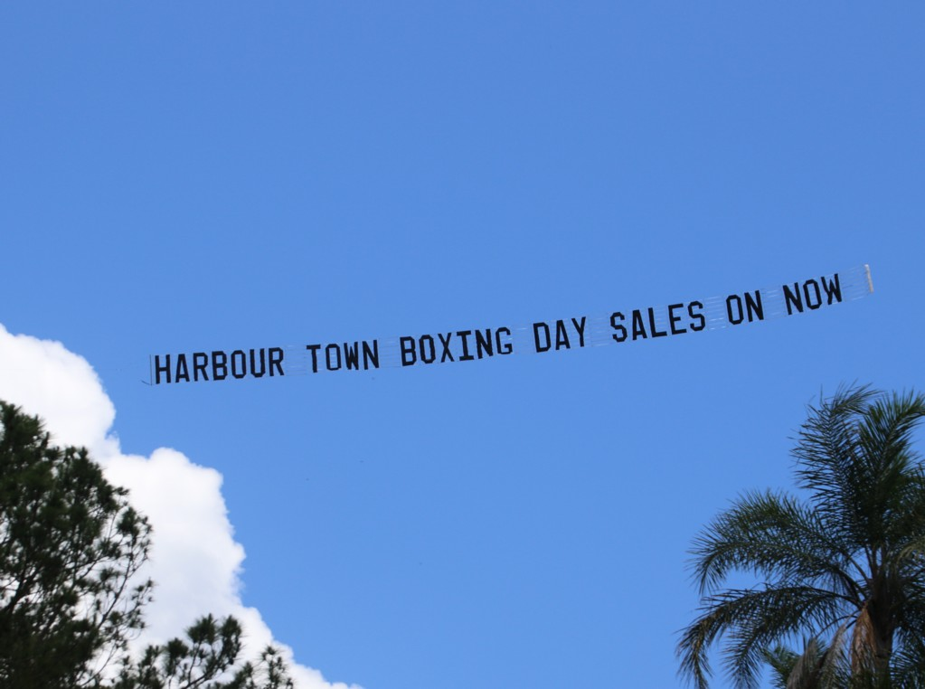 """Sky Banner reads """"Harbour Town Boxing Days Sales On Now"""""""