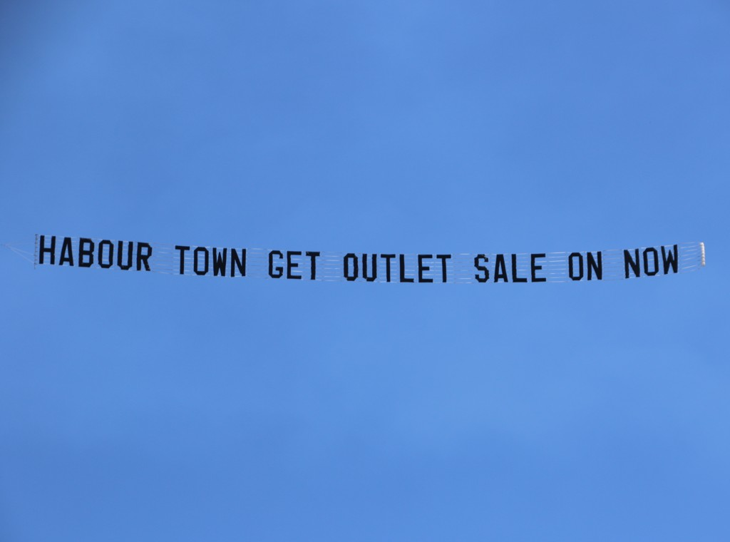 Sky Advertising reads Harbour Town Get Outlet Sale on Now