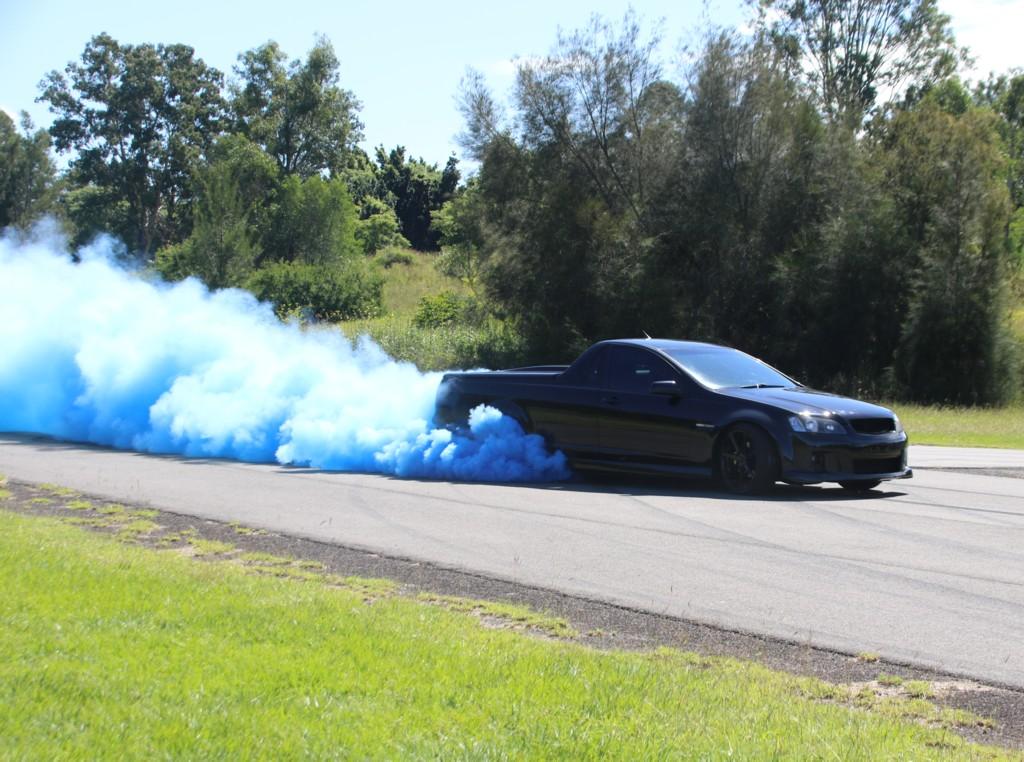 Gender Reveal Burn Out Car puffs Blue Smoke