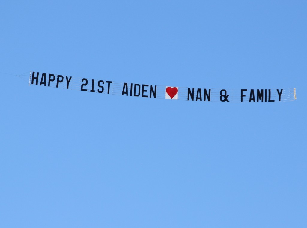 "Birthday Banner reads ""Happy 21st Aiden love Nan & Family"
