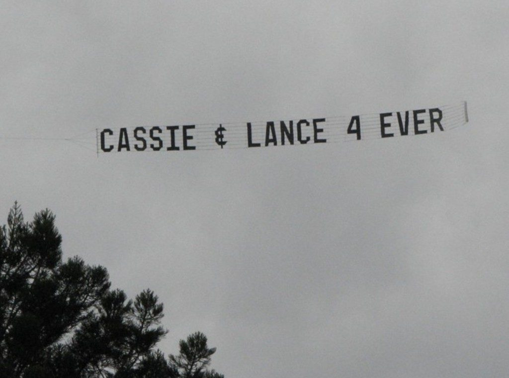 Banner Tow reads. Cassie & Lence 4 ever. in an aerial display