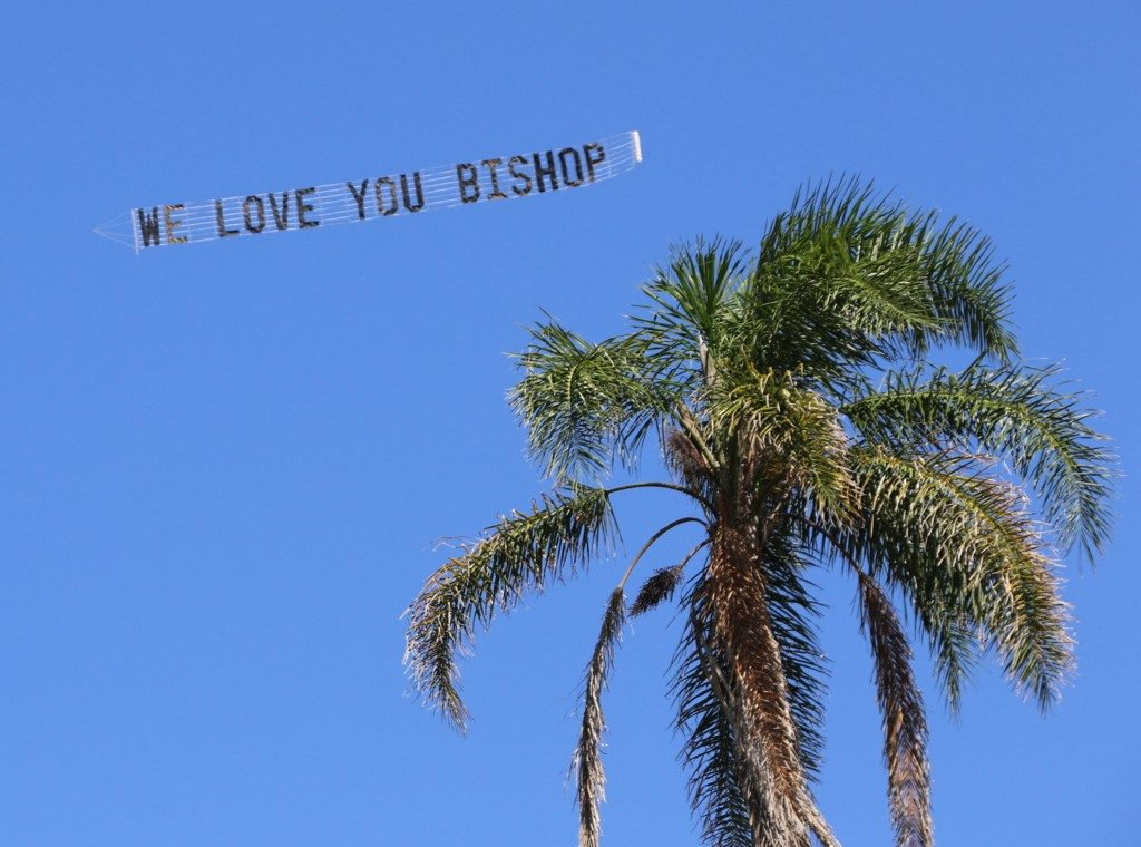 "Sky sign reads ""Love you Bishop"""