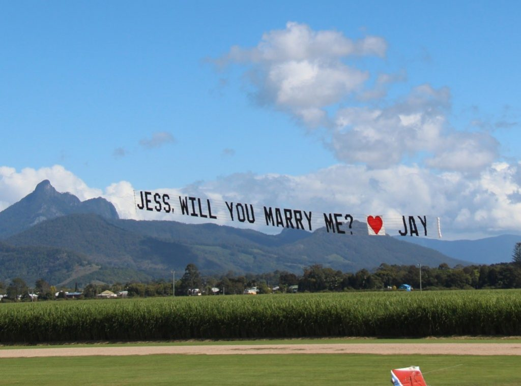 a marriage proposal banner takes off into the air