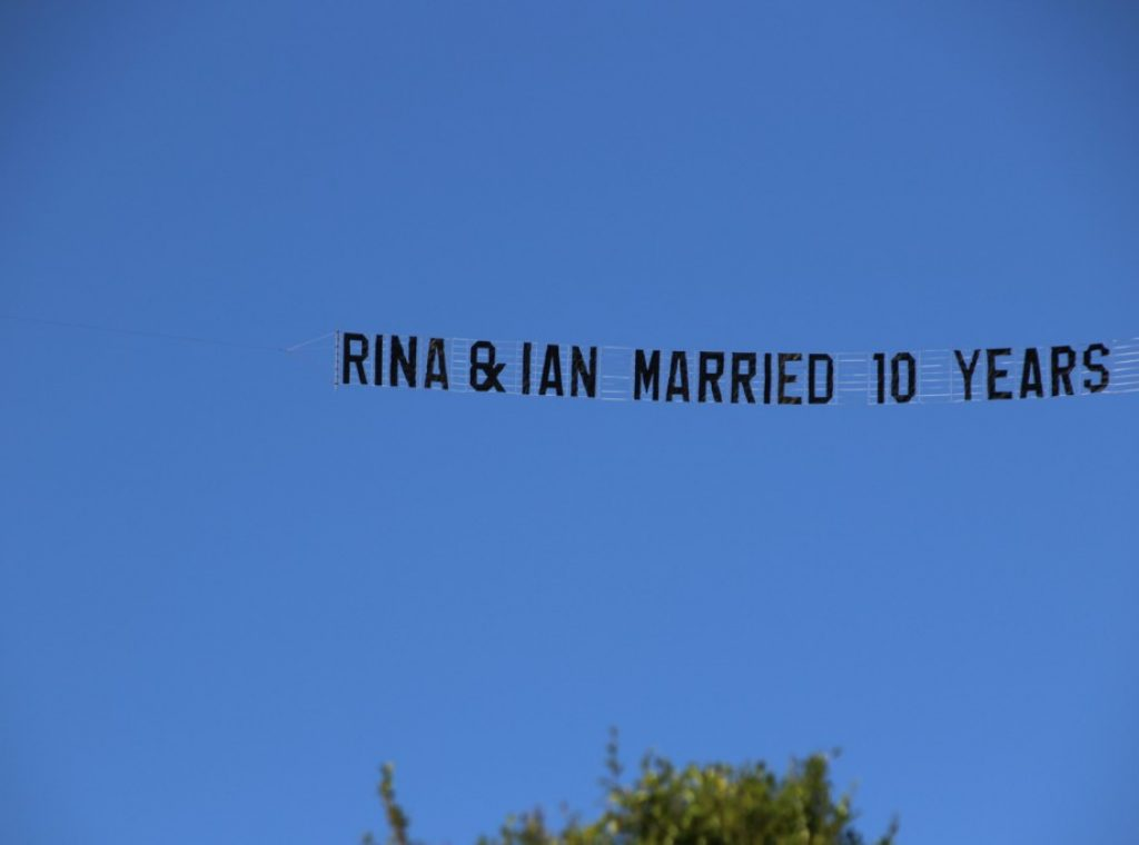 "Wedding Anniversary Banner reads ""Rina & Ian Married 10 Years"""