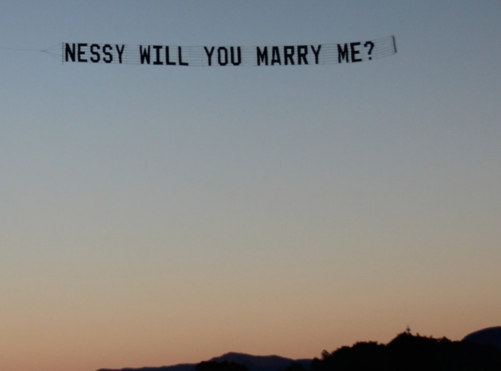 early morning proposal banner tow