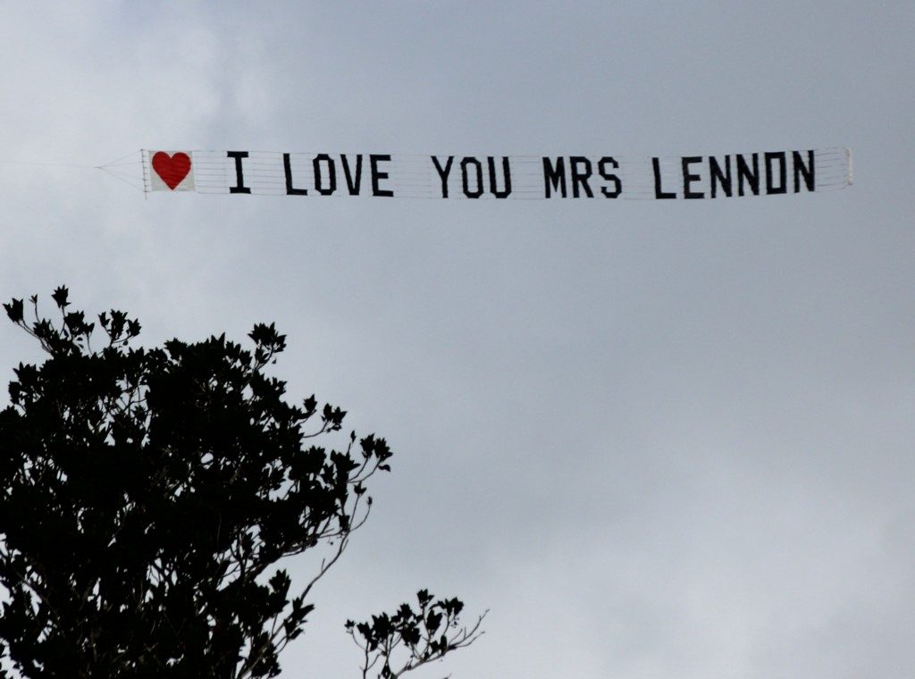 love you message flying over tree on a cloudy day