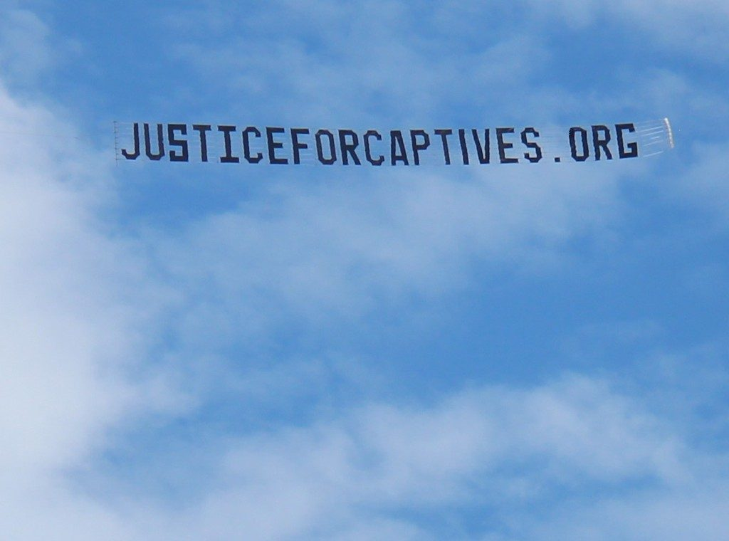 protest JUSTICE FOR captives banner