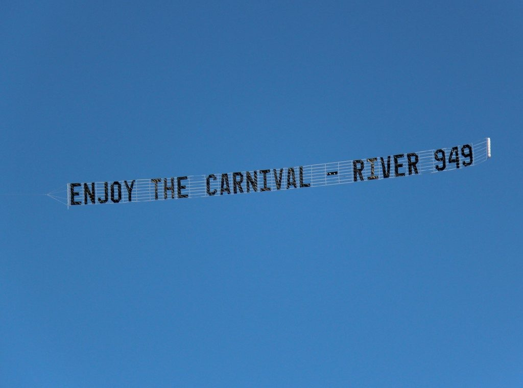 aircraft-in-the-sky-with-flying-sign
